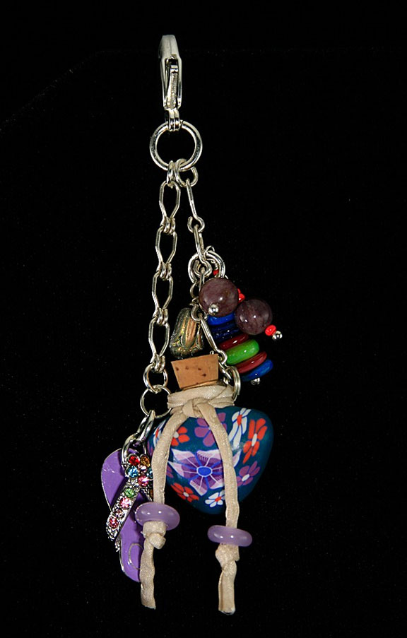 This piece of aromatherapy jewelry can clip onto your purse or belt loop.