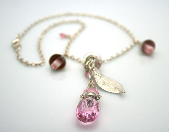 Aromatherapy jewelry with pink faceted mini-perfume bottle, sterling silver chain and pretty bells and beads