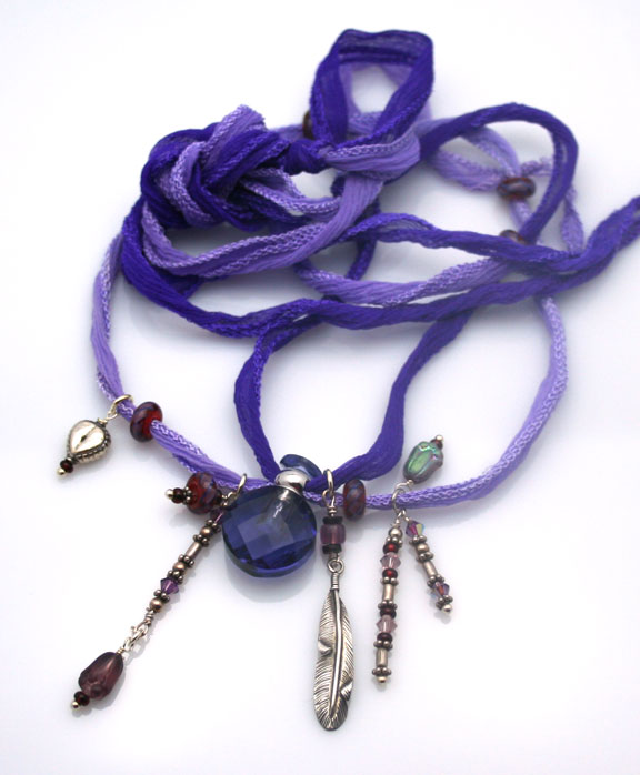 Purple passion aromatherapy necklace with sterling silver beads and charms