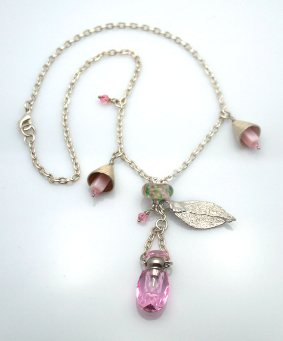 Close up of Pink Delicacy aromatherapy necklace