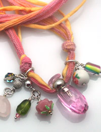 pink aromatherapy necklaces with beads and charms