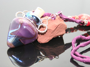 purple glass bottle necklace with silk and beads