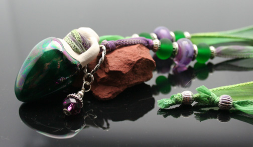 Aromatherapy jewelry featuring ceramic amphoras, silk cord or ribbon, and beautiful beads