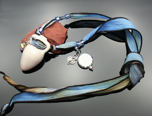 photo of blue watercolor ribbon and pendant