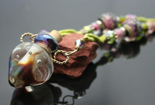 One-of-a-kind aromatherapy necklaces with silk cords and sterling silver beads
