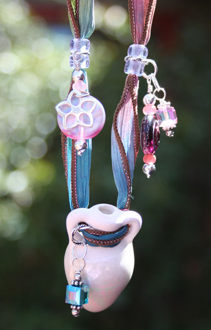 photo of the unique and beautiful aromatherapy necklace hanging in the sun