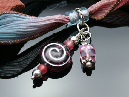 Photo of crystal dangles with silver findings and a Czech glass spiral bead